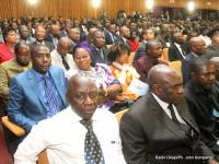 Des participants aux Concertations nationales au palais de congrès à Kinshasa